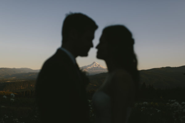 Couple with Mount Hood at Gorge Crest Vineyards