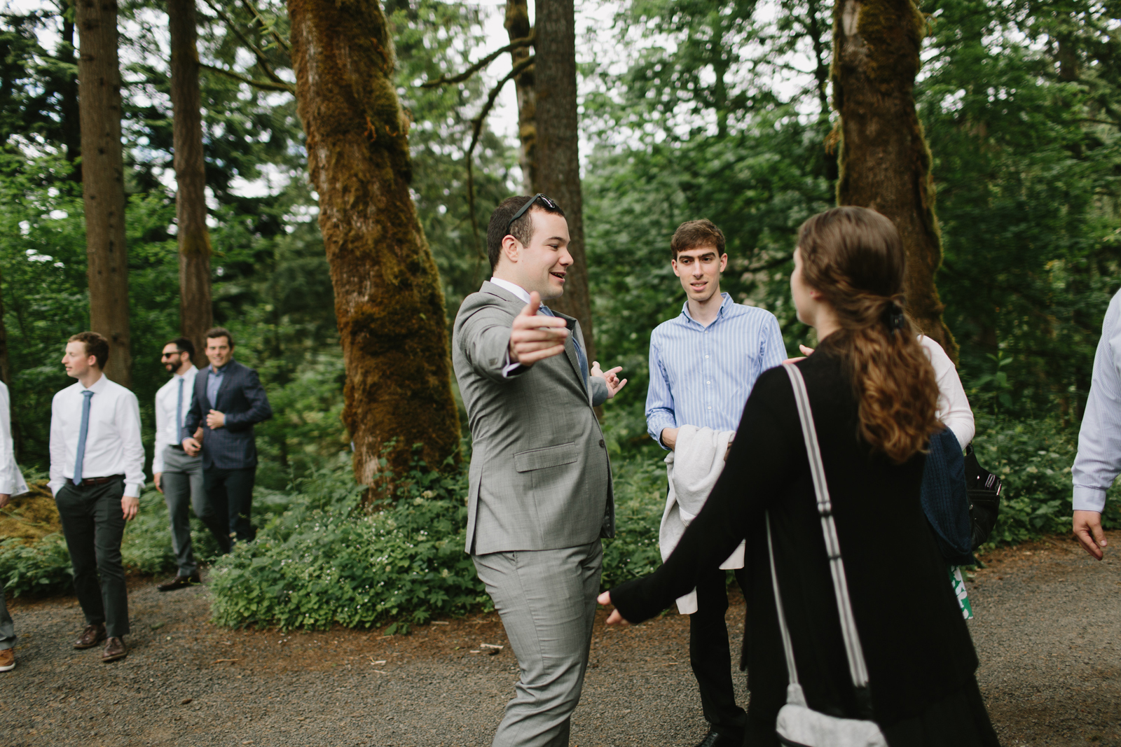 The groom hugs guests at Bridal Veil Lakes wedding in Corbett, OR