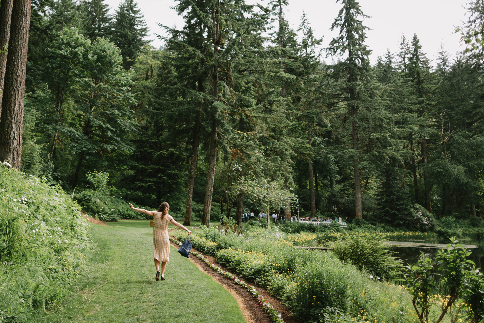 wedding guest walks to ceremony site at Bridal Veil Lakes