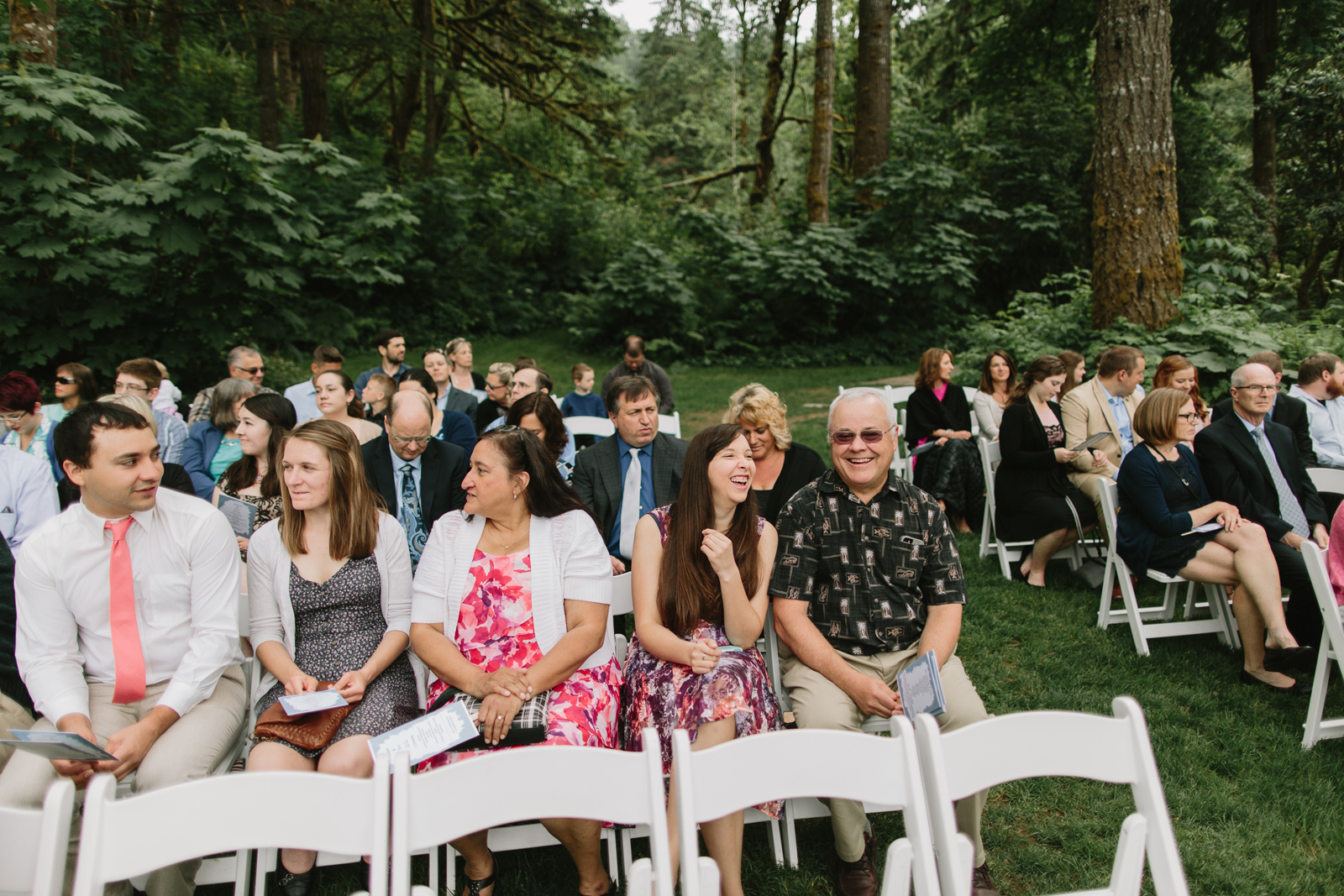 guests talk at the ceremony site at Bridal Veil Lakes in Corbett, OR
