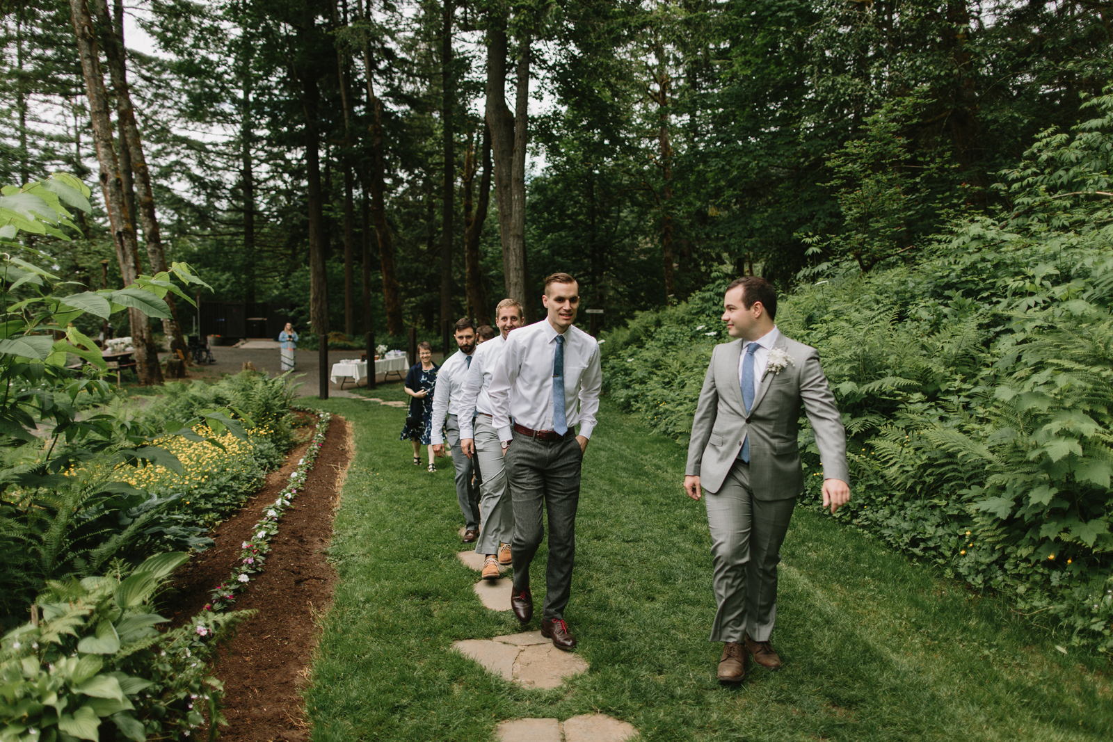 The groom and groomsmen make their way to the ceremony site at Bridal Veil Lakes in Corbett, OR