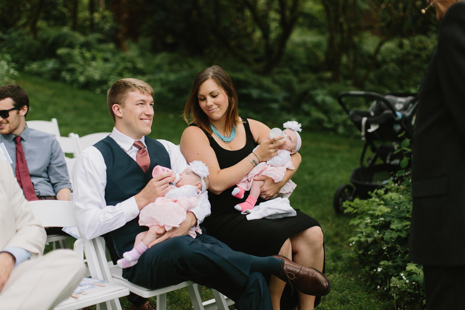 guests feed their twins before the ceremony at Bridal Veil Lakes in Corbett, OR