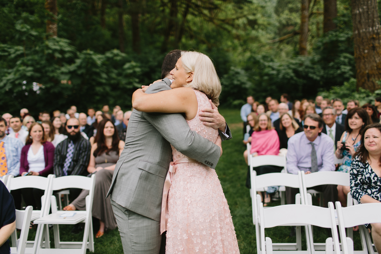 The groom hugs the mother of the bride during ceremony at Bridal Veil Lakes in Corbett, OR