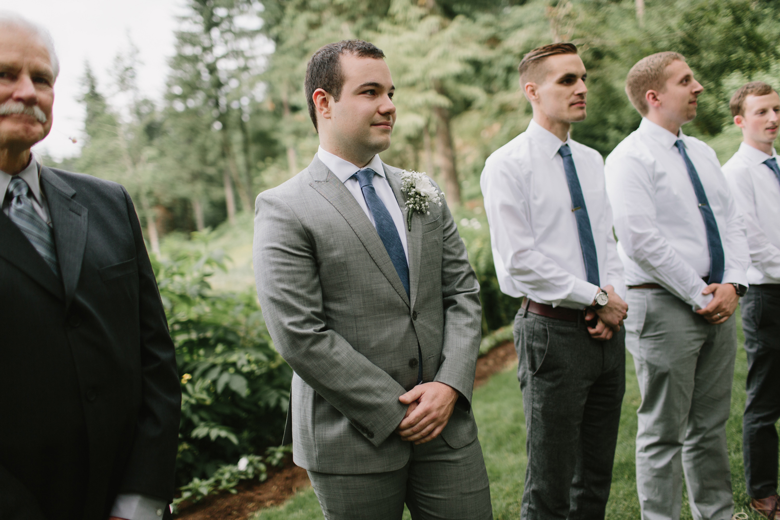 The groom before his bride walks down the aisle at Bridal Veil Lakes in Corbett, OR