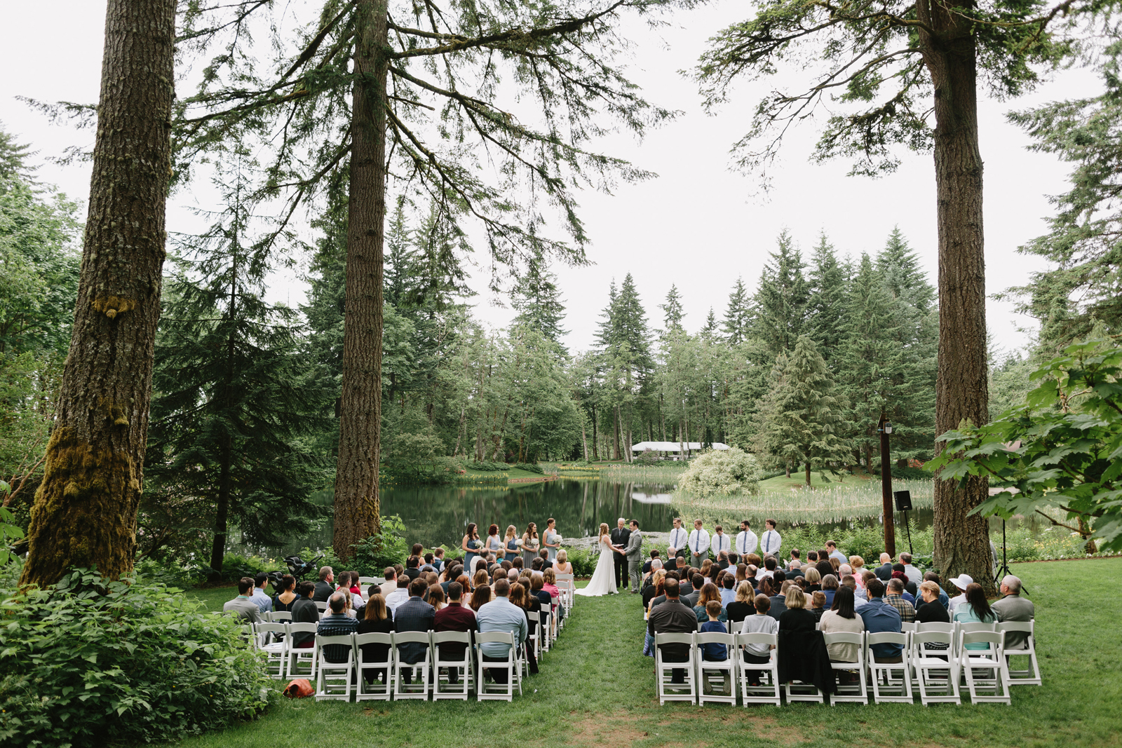 A wide shot of the ceremony at Bridal Veil Lakes in Corbett, Oregon