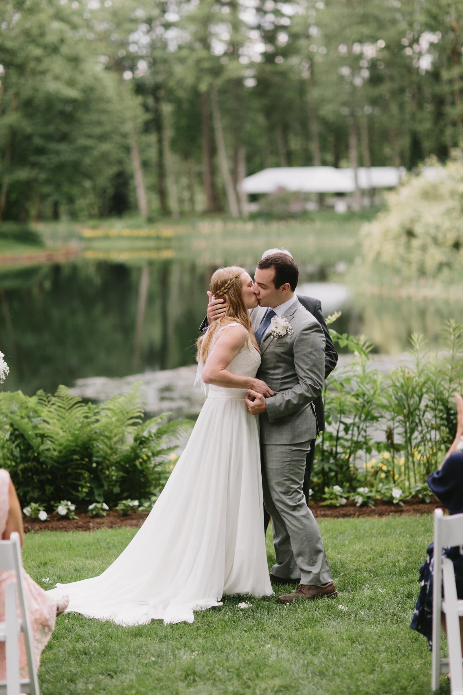 The first kiss between the bride and groom at Bridal Veil Lakes