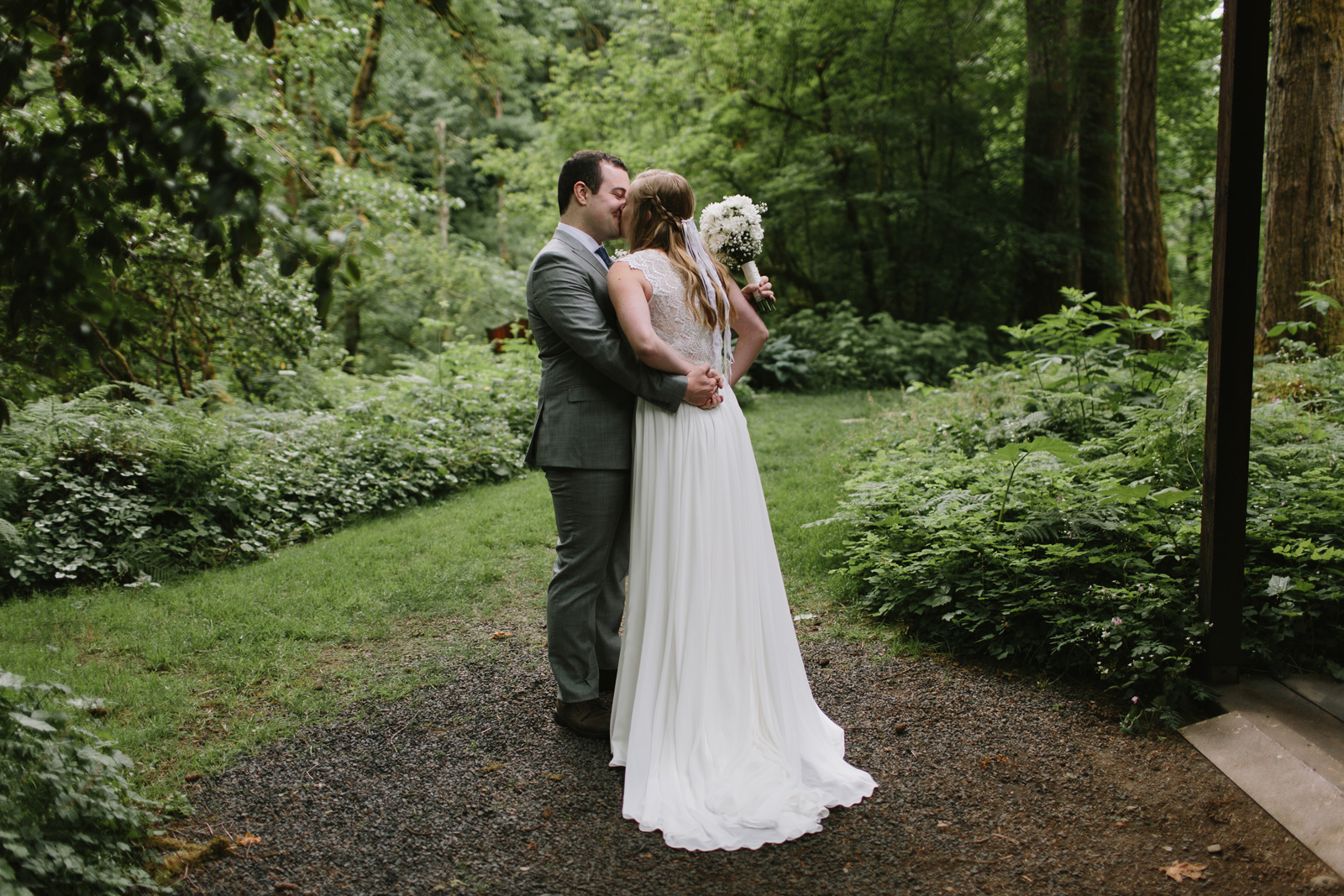 The bride and groom kiss after being married at Bridal Veil Lakes in Corbett, OR