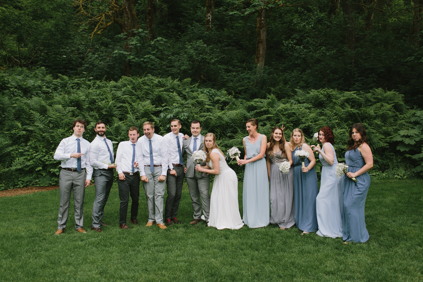 The wedding party takes a goofy photo at Bridal Veil Lakes