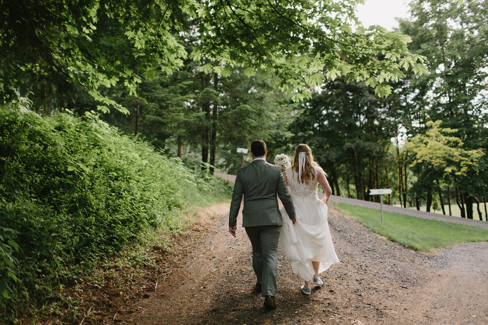 The bride and groom walk to the reception at Bridal Veil Lakes in Corbett, Oregon
