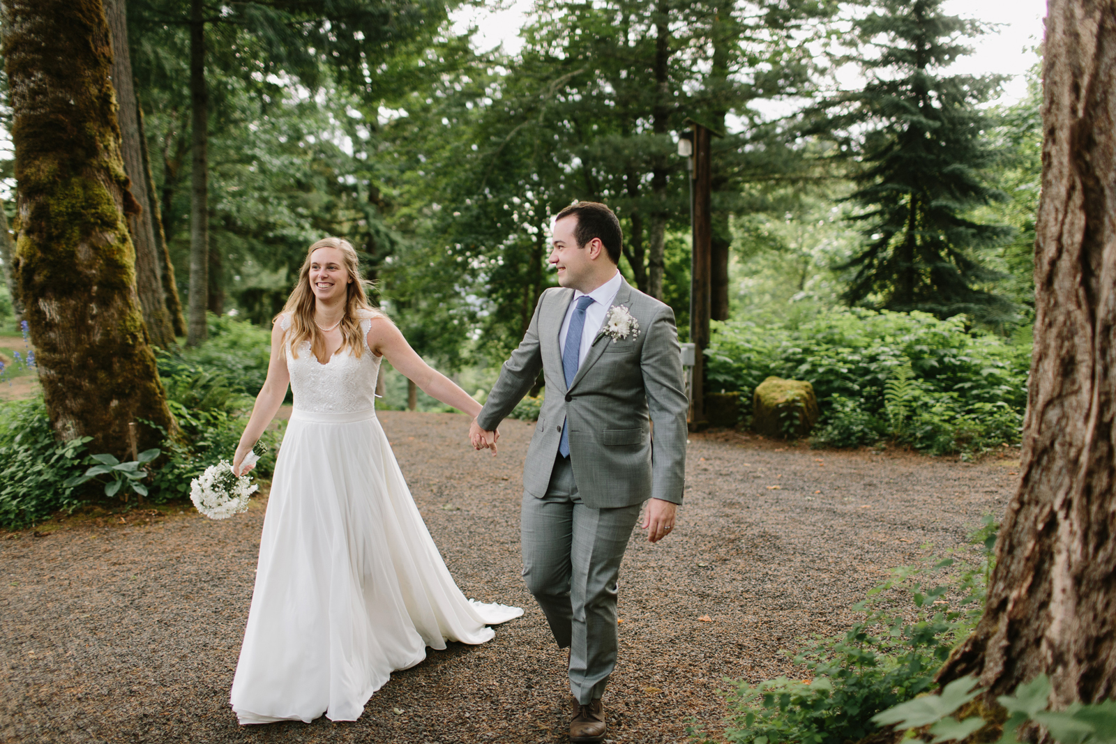 The bride and groom dance their way into the reception entrance at Bridal Veil Lakes in Corbett, Oregon