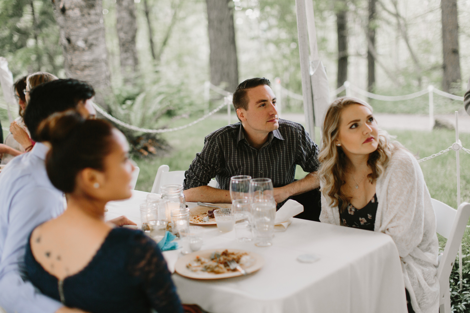 Guests chat at wedding reception at Bridal Veil Lakes in Corbett, OR