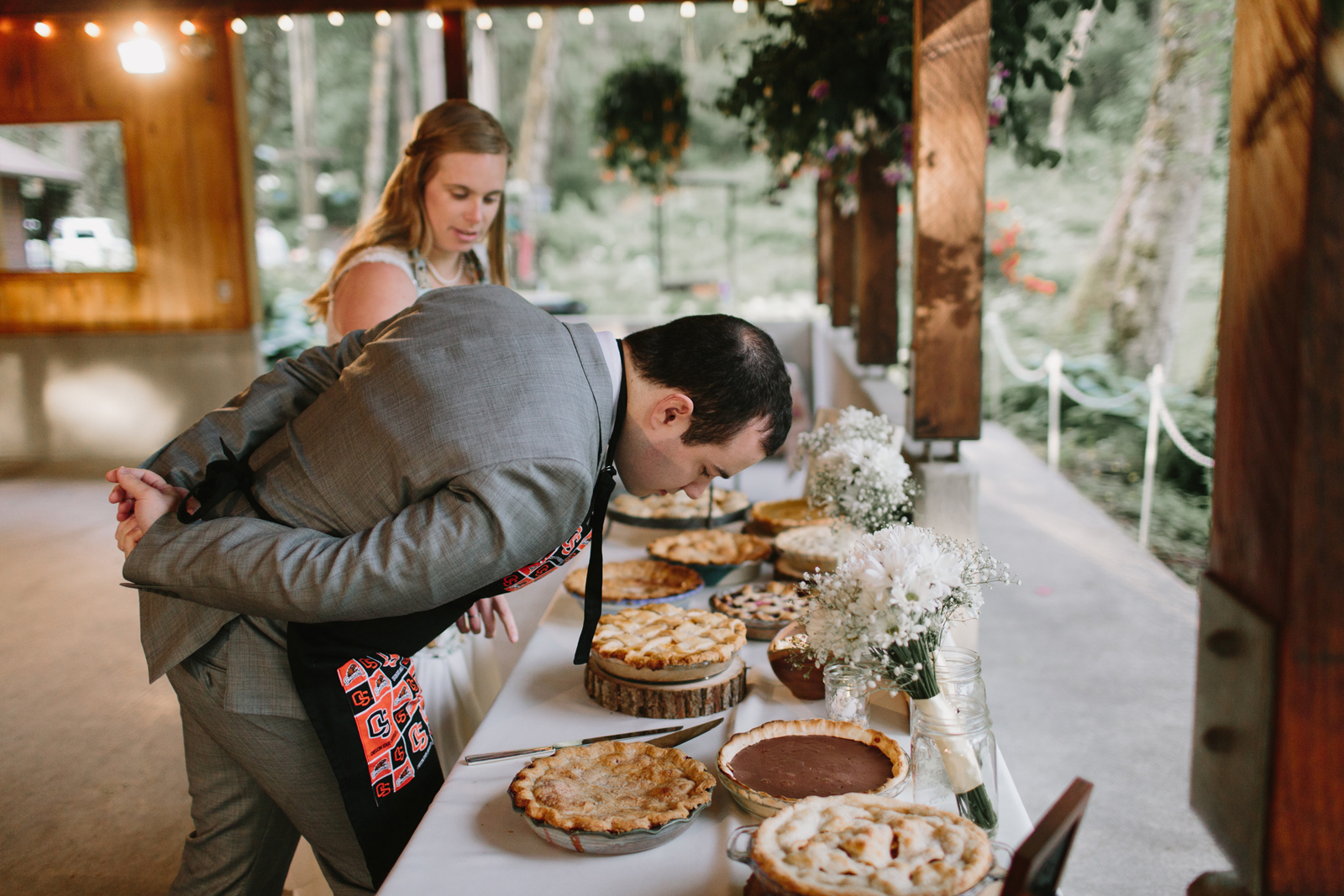 The groom sniffs the pies at Bridal Veil Lakes in Corbett, OR
