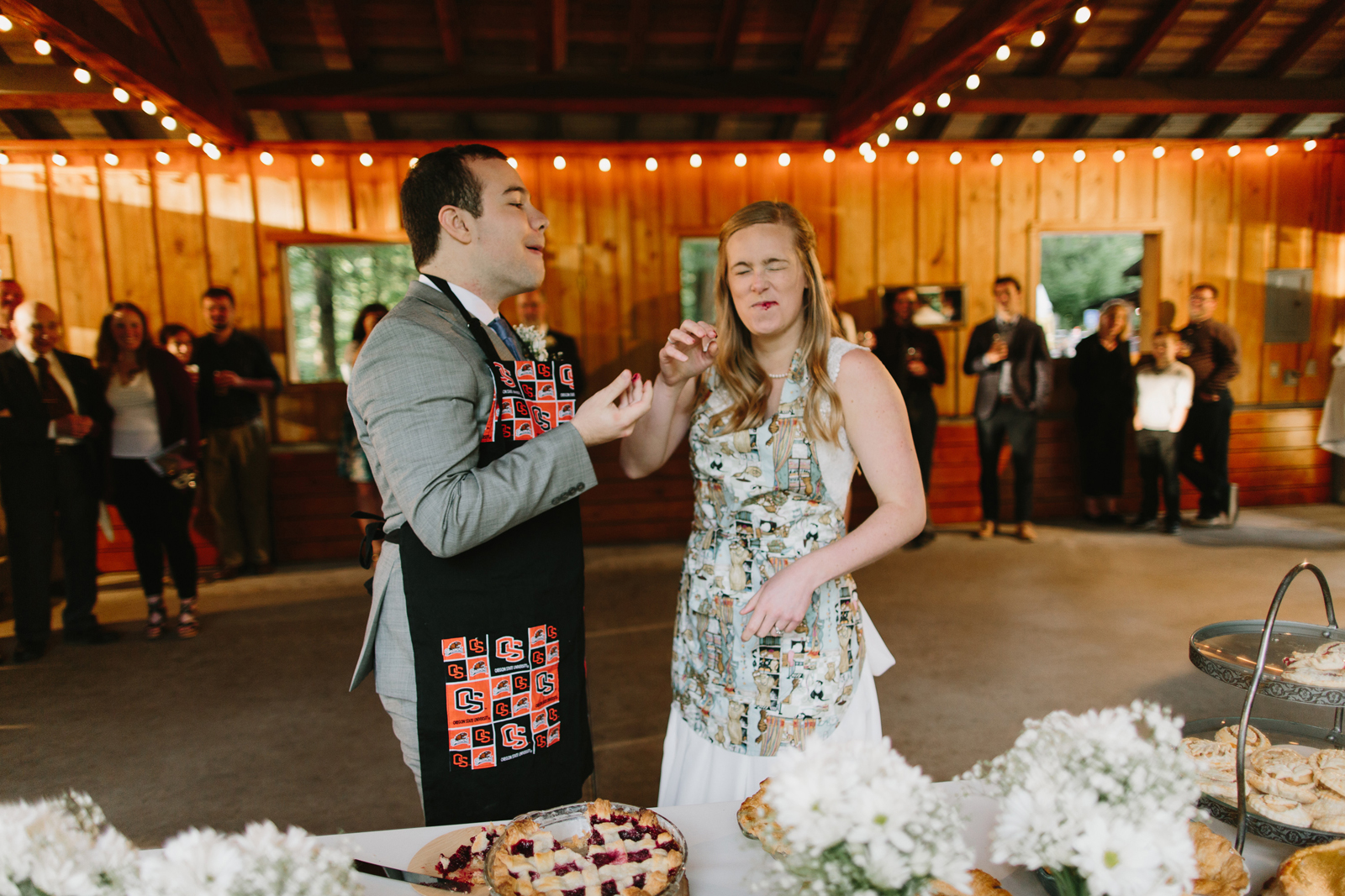 The bride and groom cut pie at wedding reception at Bridal Veil Lakes in Corbett, OR