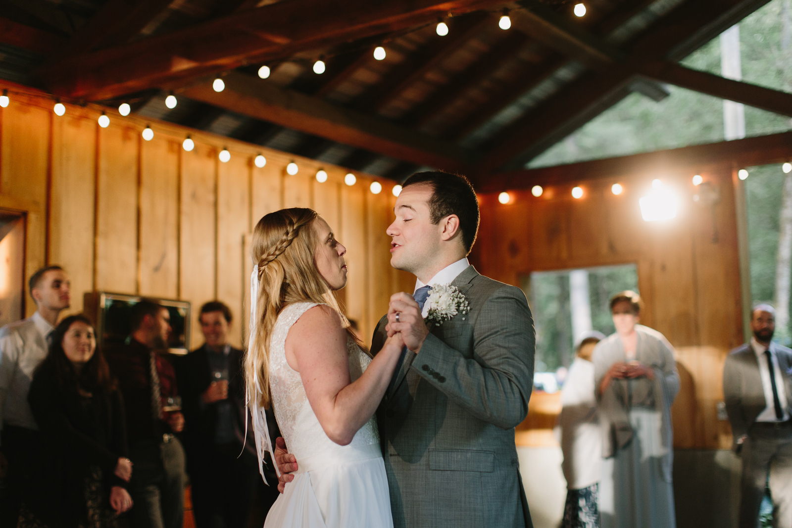 the bride and groom have their first dance at wedding reception at Bridal Veil Lakes in Corbett, Oregon