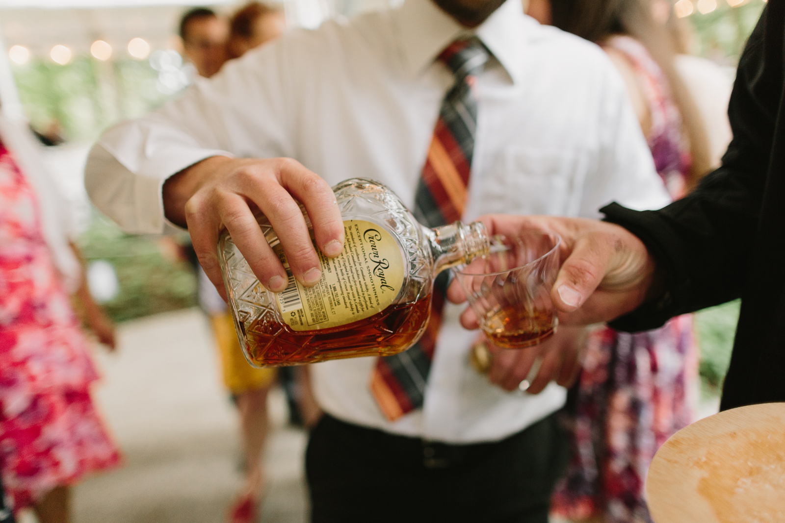 Tequila is poured at wedding reception at Bridal Veil Lakes in Corbett, Oregon