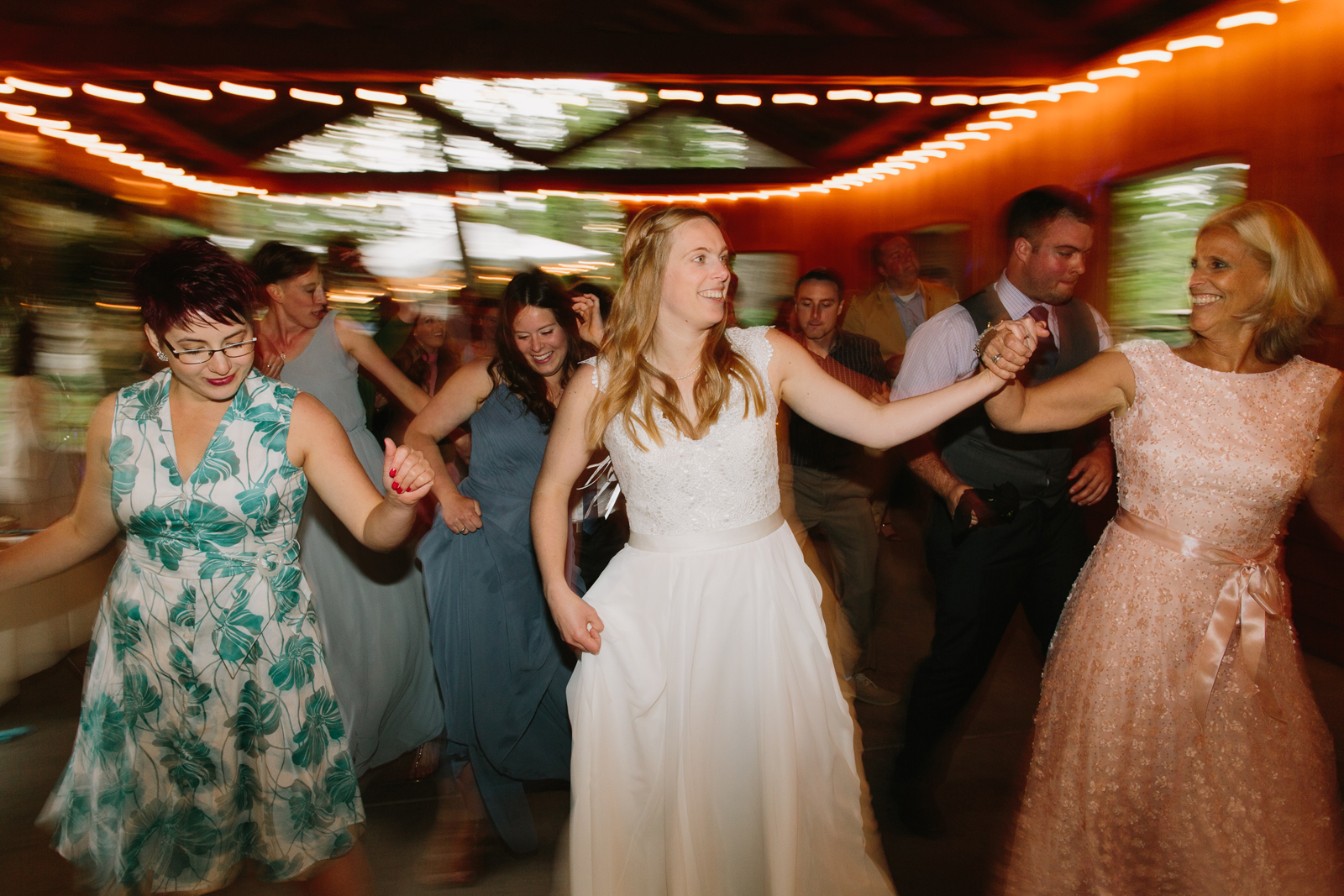 The bride dances with her mom at Bridal Veil Lakes