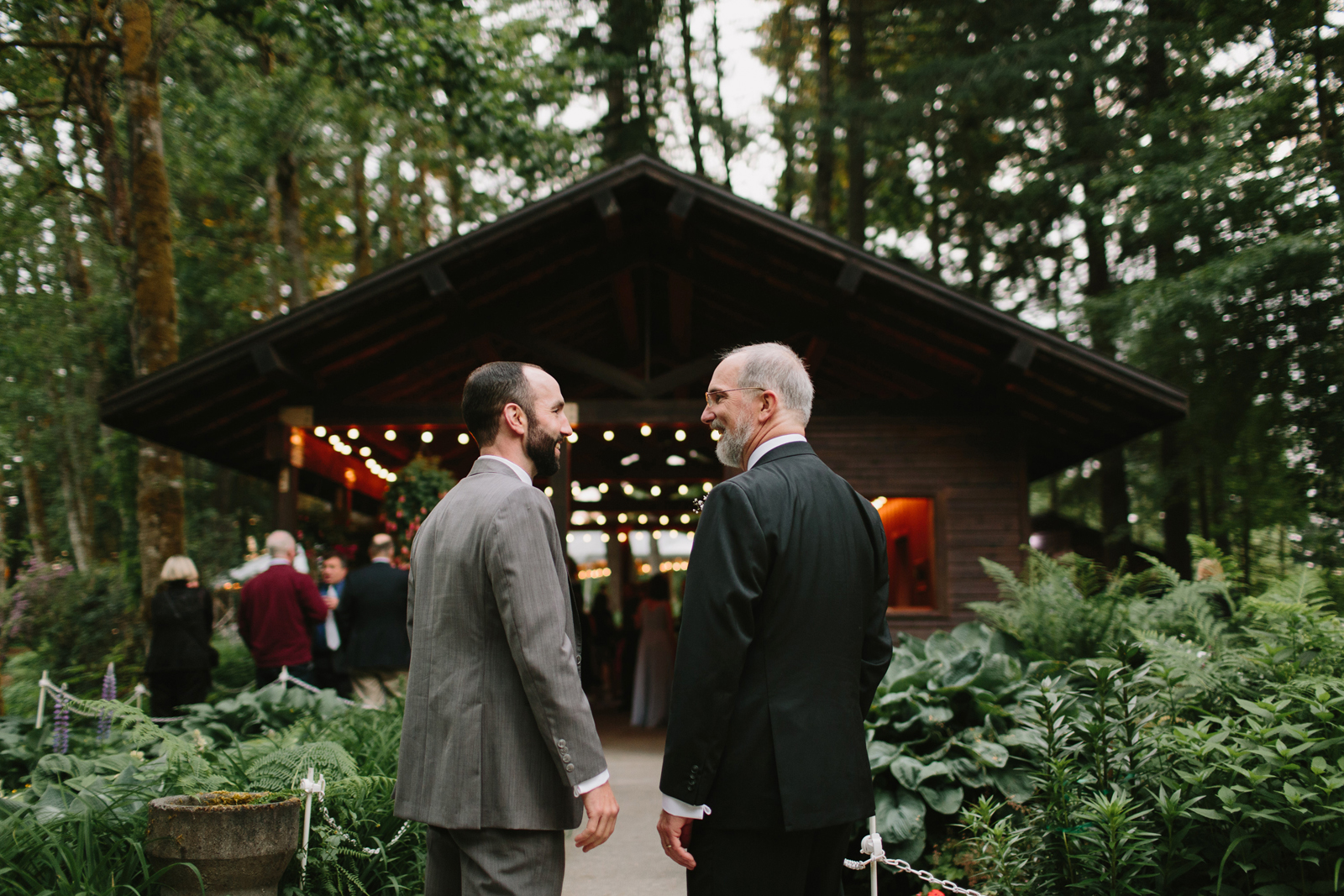 guests chat outside during wedding reception at Bridal Veil Lakes