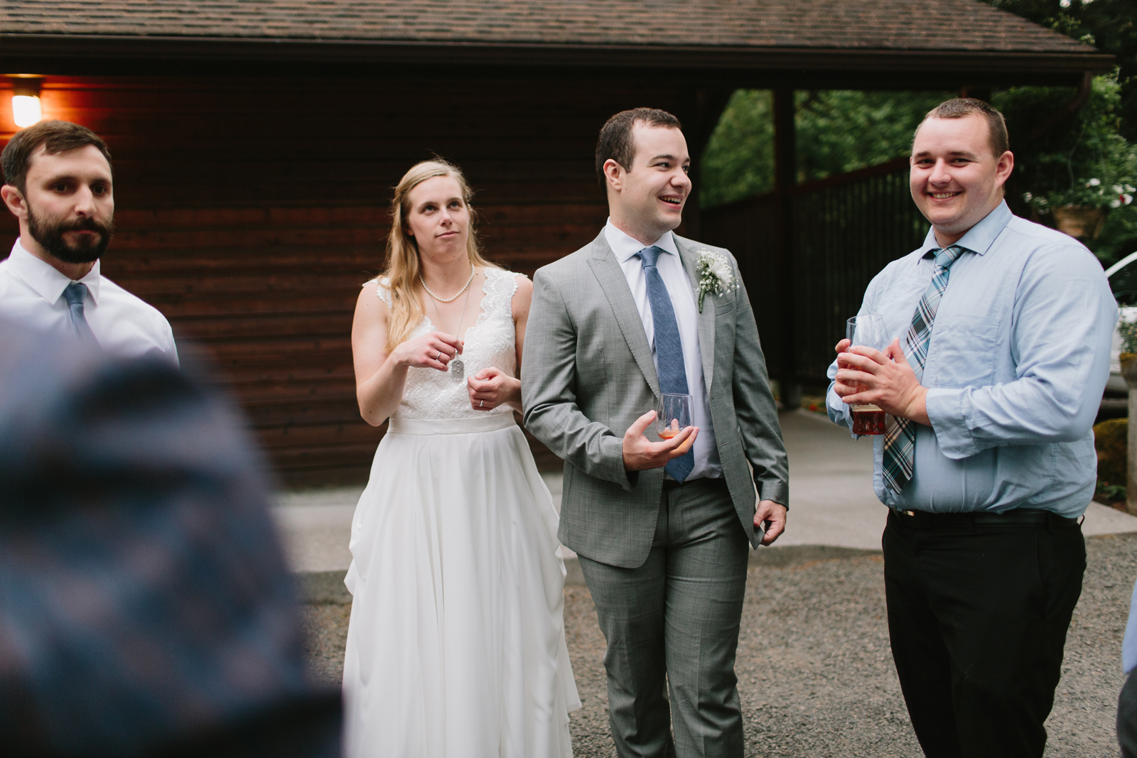 The bride and groom chat during wedding reception at Bridal Veil Lakes in Corbett, Oregon