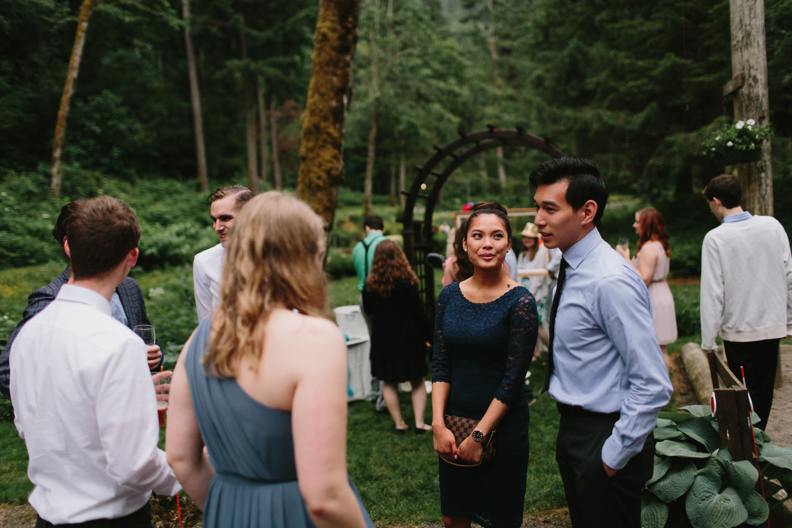 Guests chat during wedding reception at Bridal Veil Lakes in Corbett, Oregon