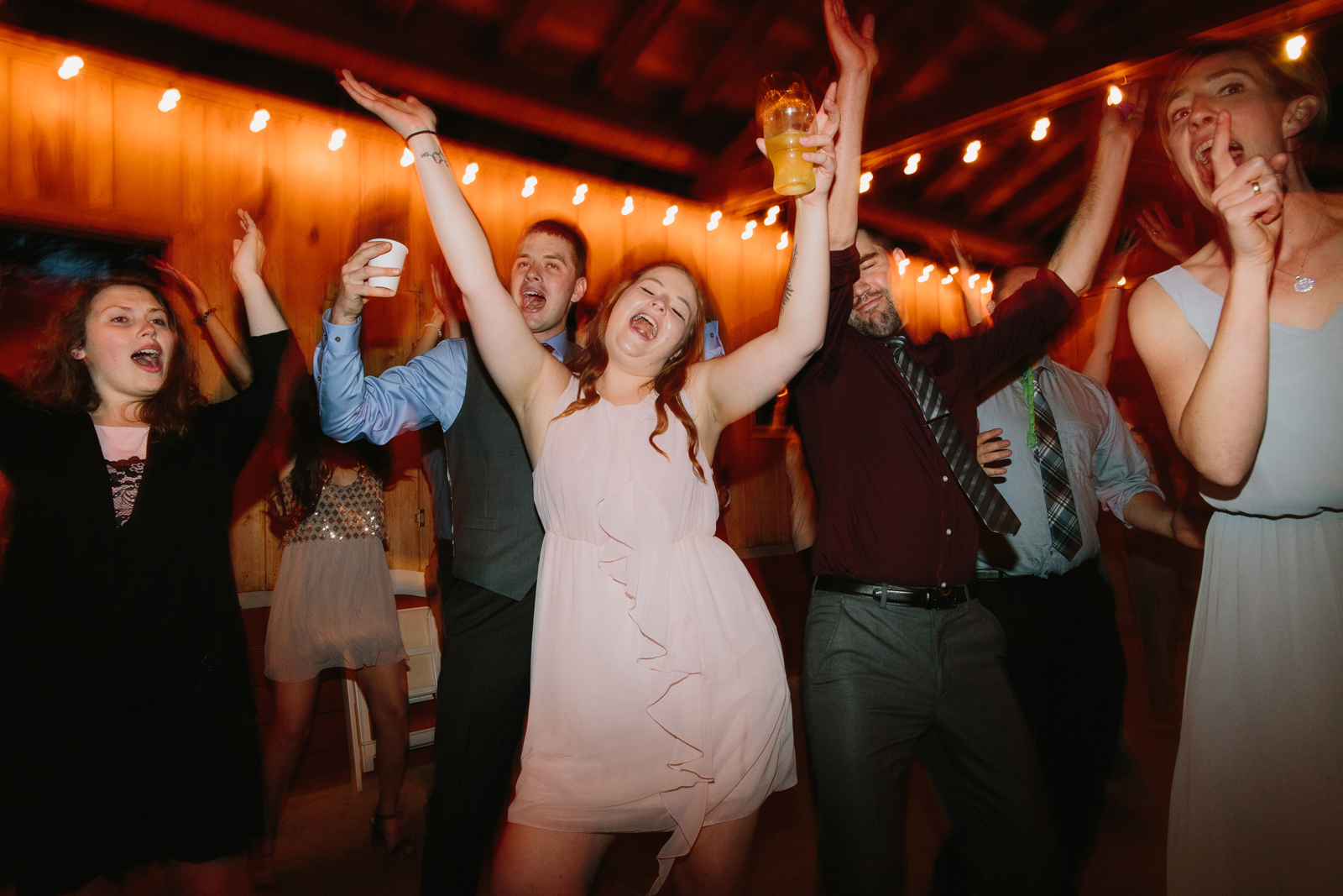 Guests dance during a wedding reception at Bridal Veil Lakes in Oregon