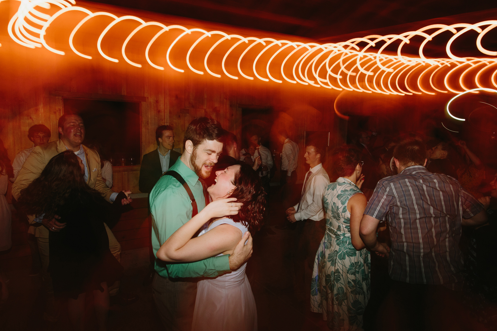 Wedding guests dance on the dance floor during a wedding reception at Bridal Veil Lakes in Corbett, Oregon