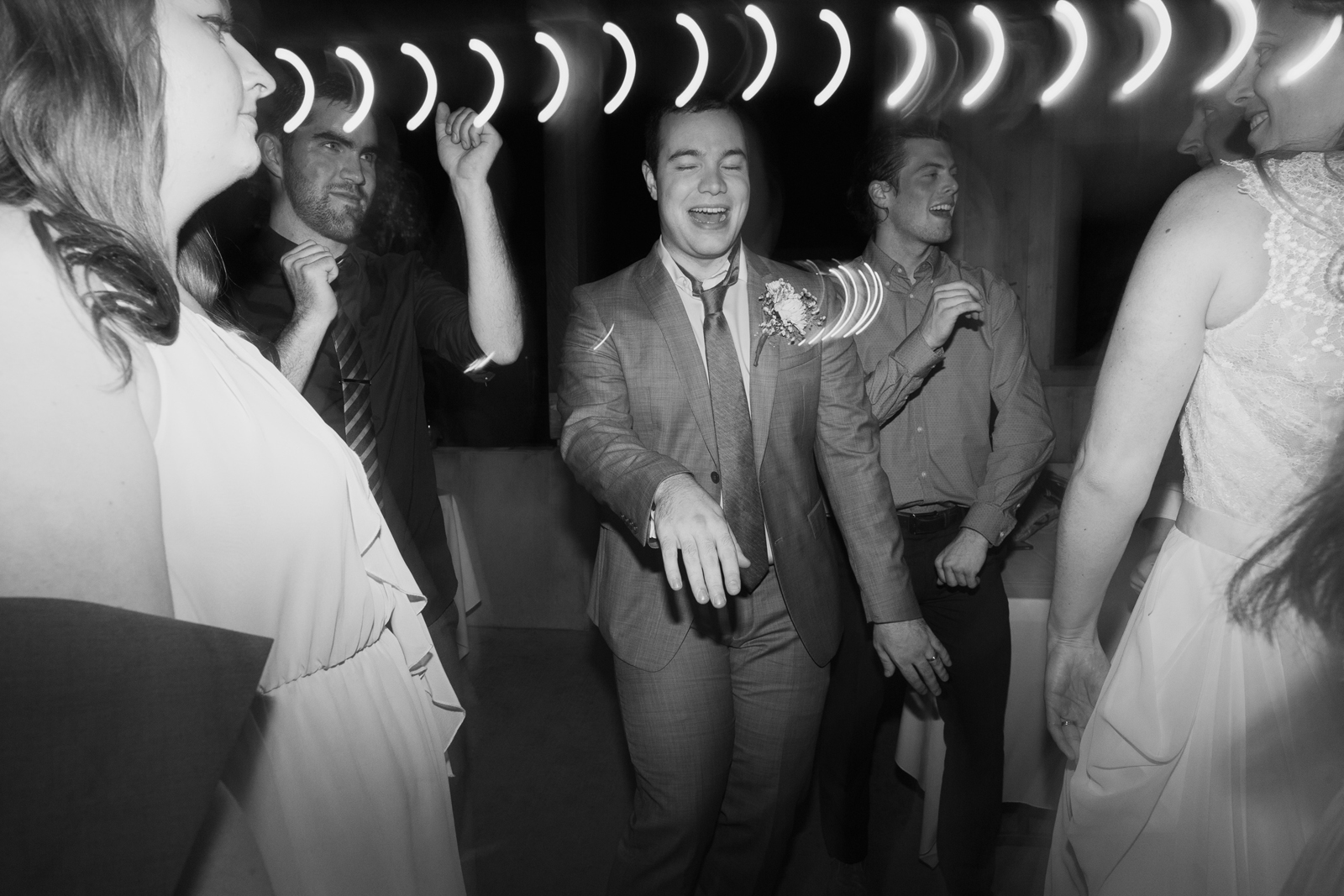 The groom dances during a wedding reception at Bridal Veil Lakes in Corbett, OR
