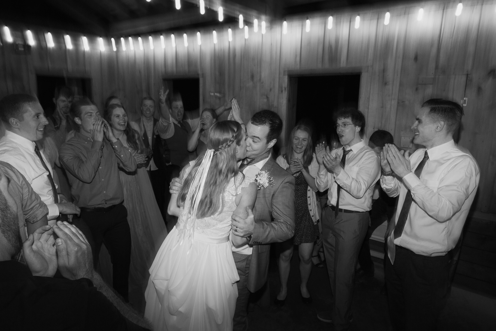 The bride and groom kiss on the dance floor during a wedding reception at Bridal Veil Lakes in Corbett, OR