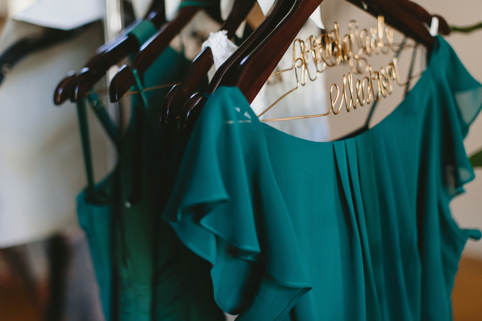 green bridesmaids dresses on personalized name hangers