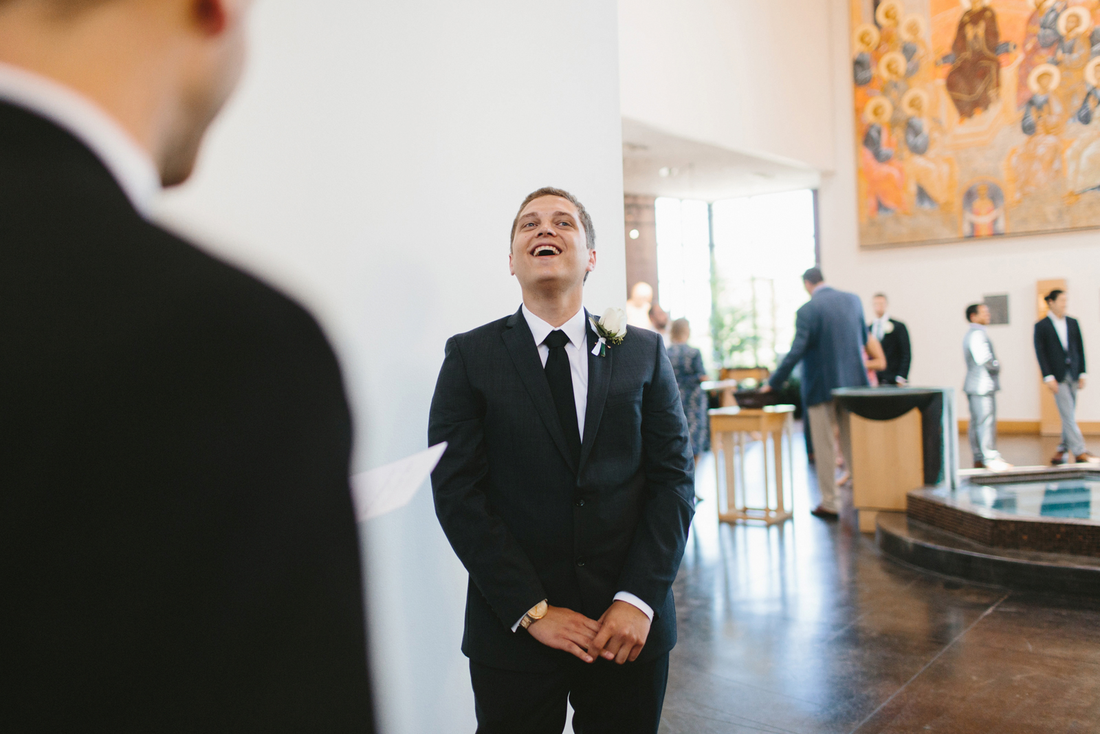 groom greets guests
