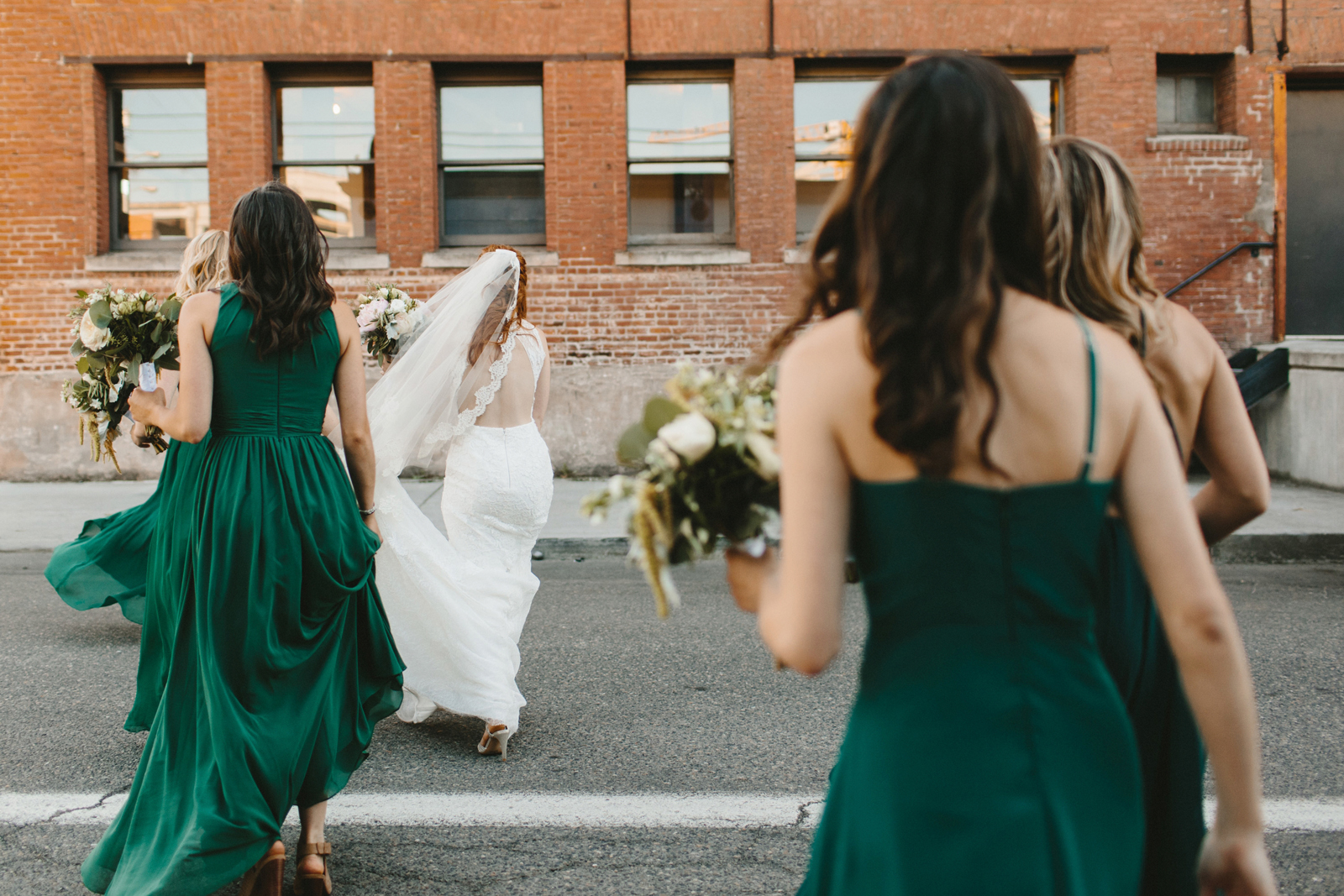 bride and bridesmaids walk outside Castaway Portland following wedding ceremony
