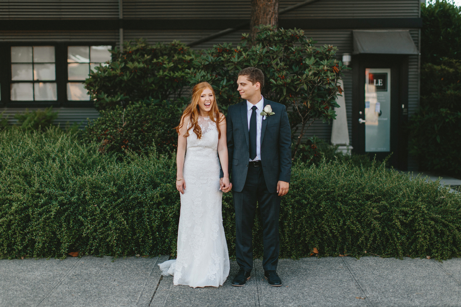 photograph of bride and groom outside Castaway Portland