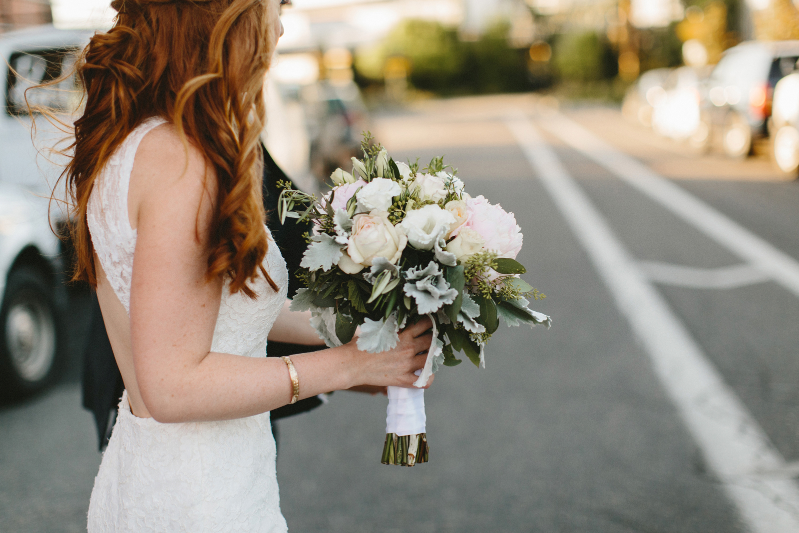 bride walks with bouquet