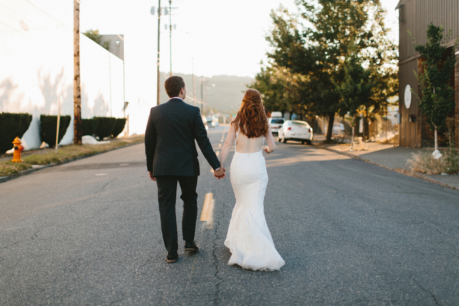 bride and groom walking through Northwest Portland Industrial District