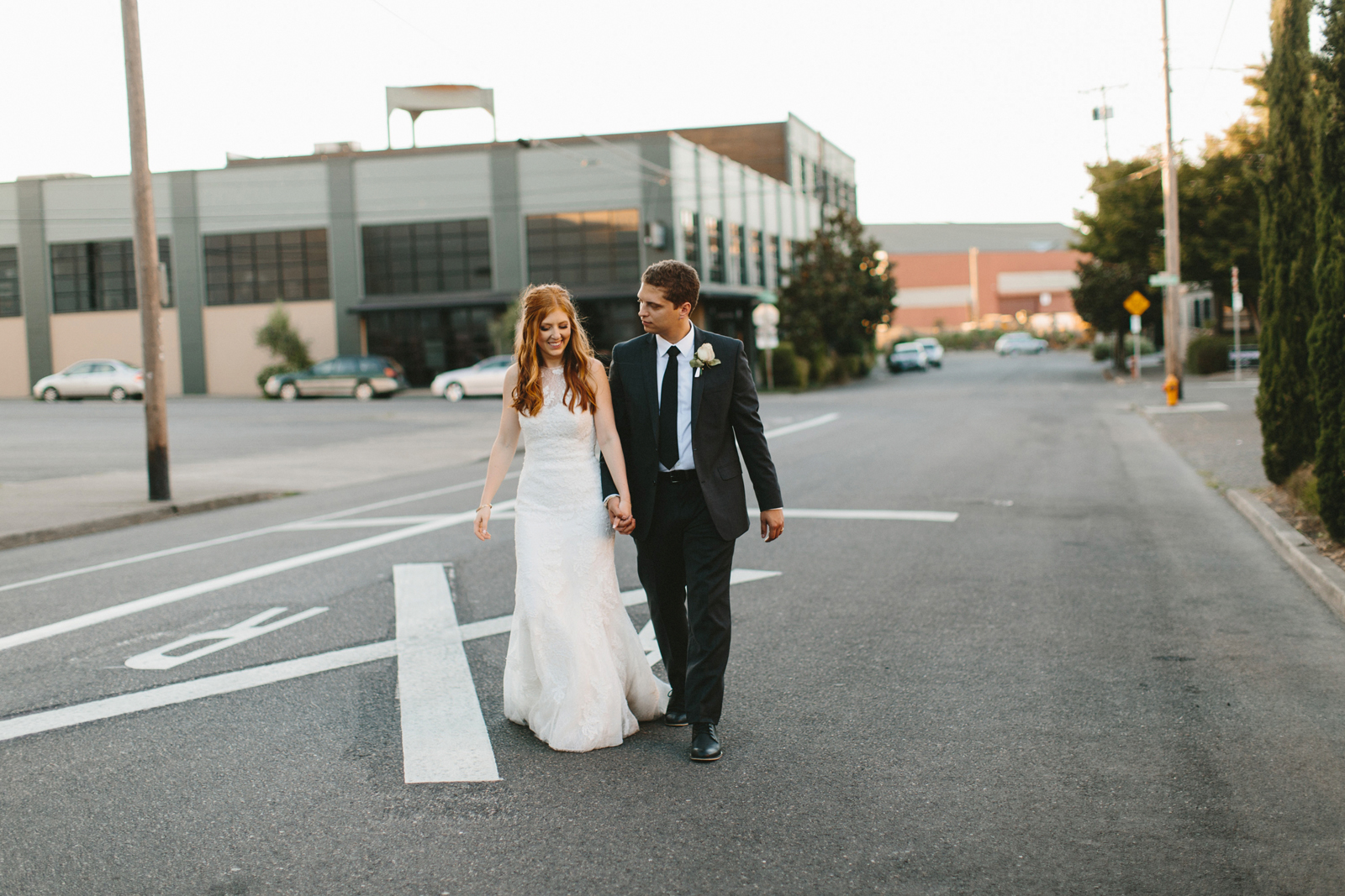 photo of bride and groom walking near Castaway Portland wedding venue