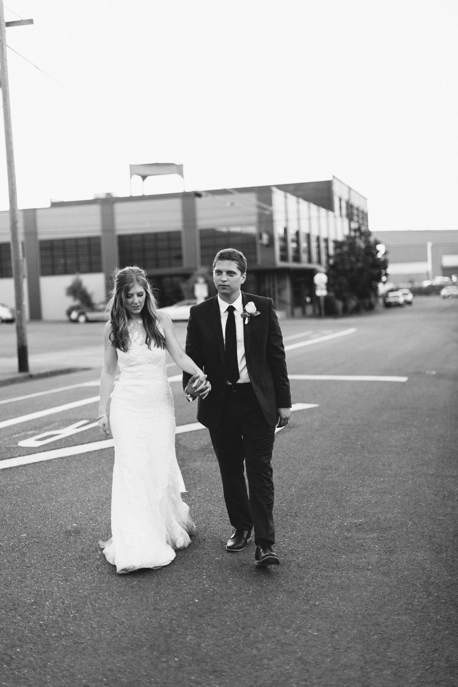 bride and groom walking near Castaway Portland
