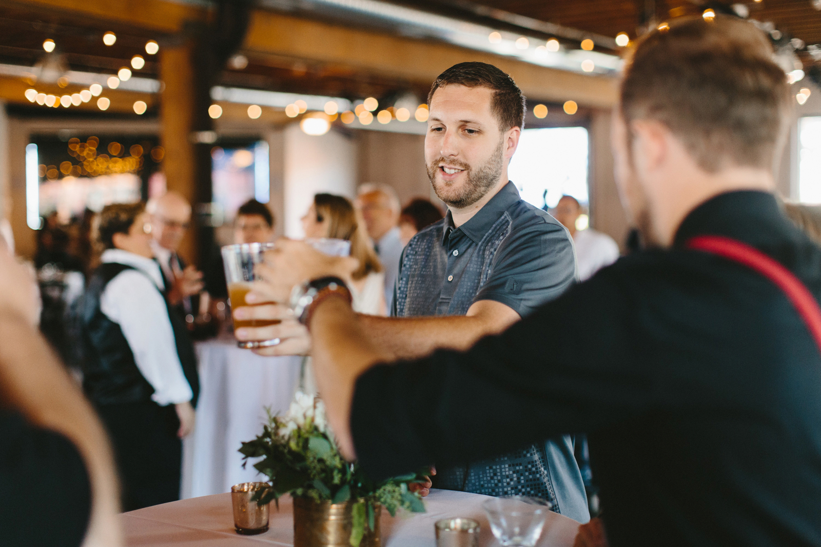 guests toast at wedding reception at Castaway Portland