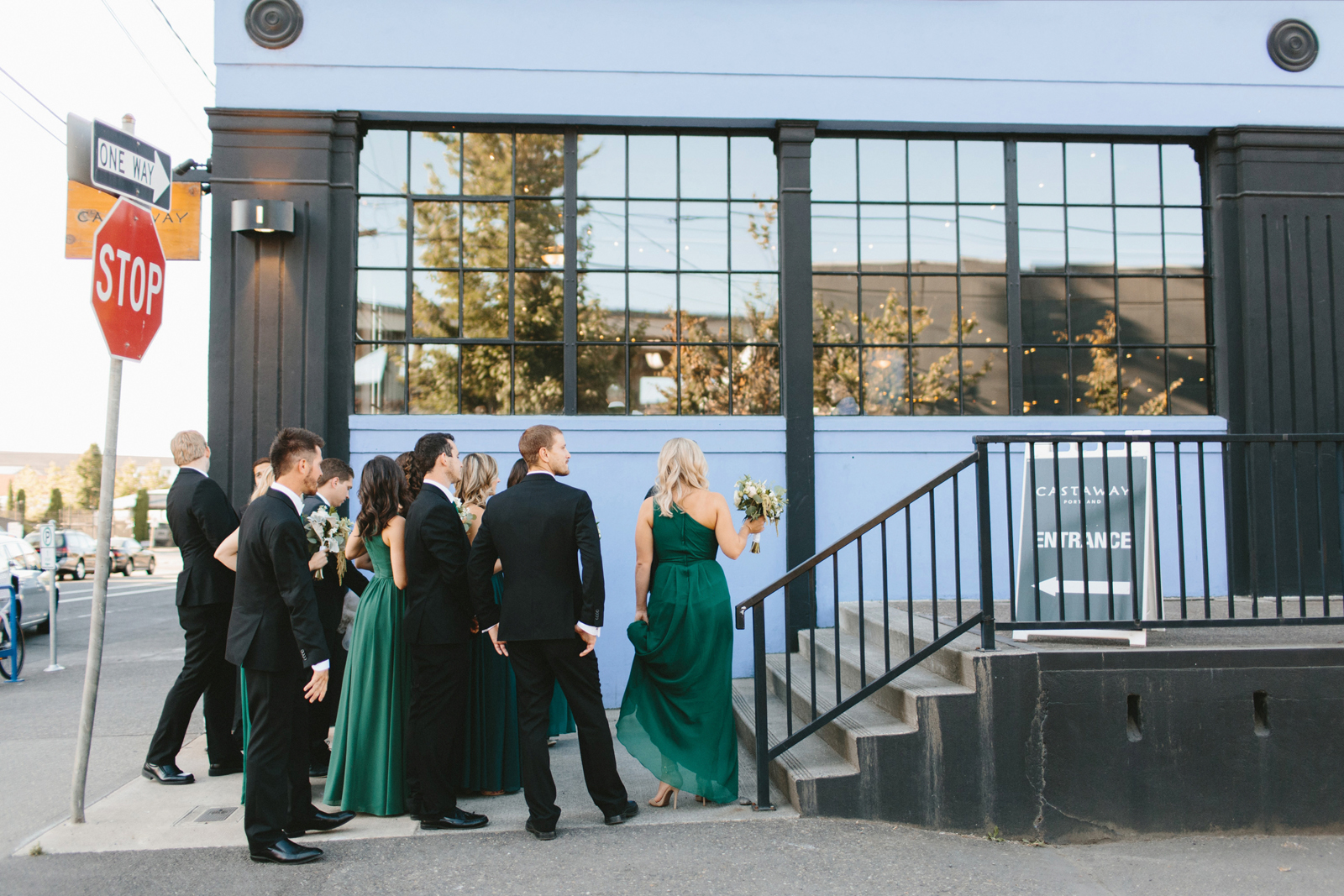 wedding party waits to enter reception venue