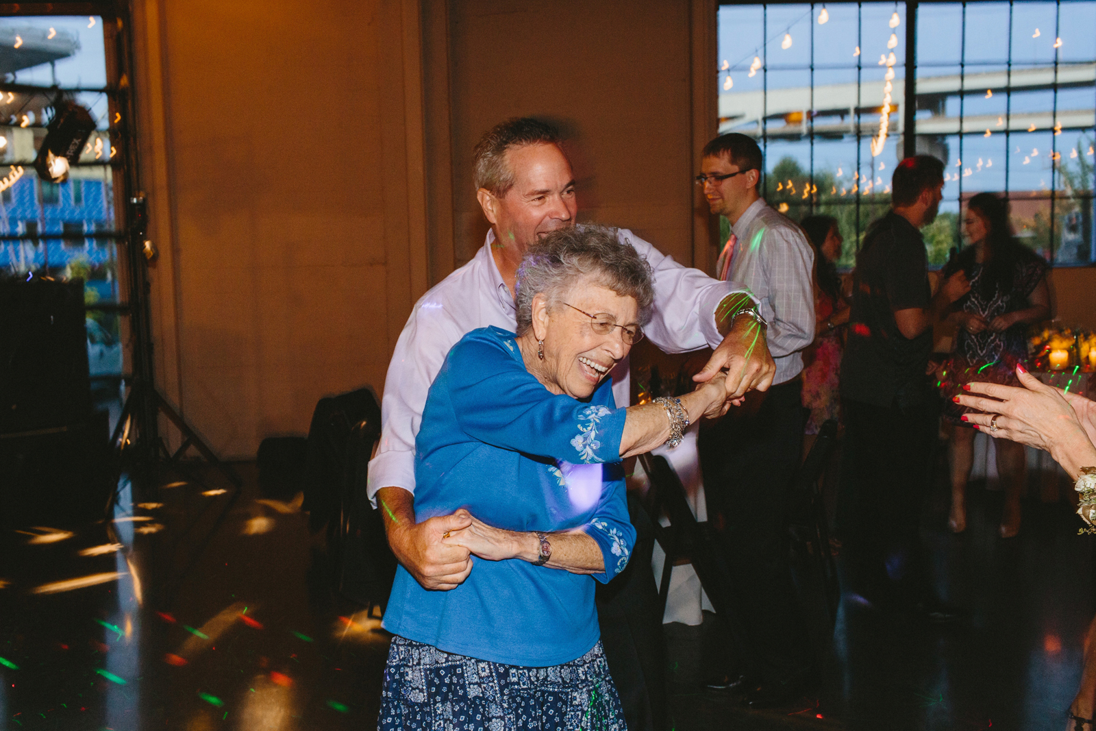 Grandma dancing at wedding reception at Castaway in Portland, Oregon