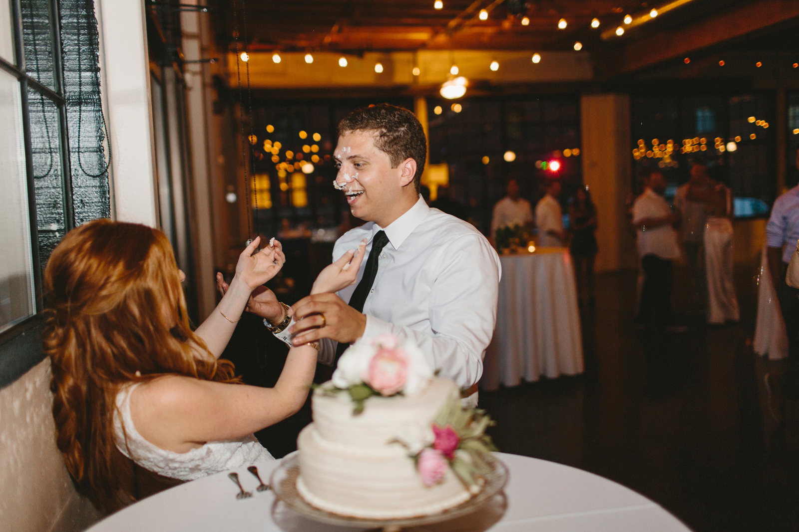 bride and groom cut the cake at Castaway Portland in Northwest Portland